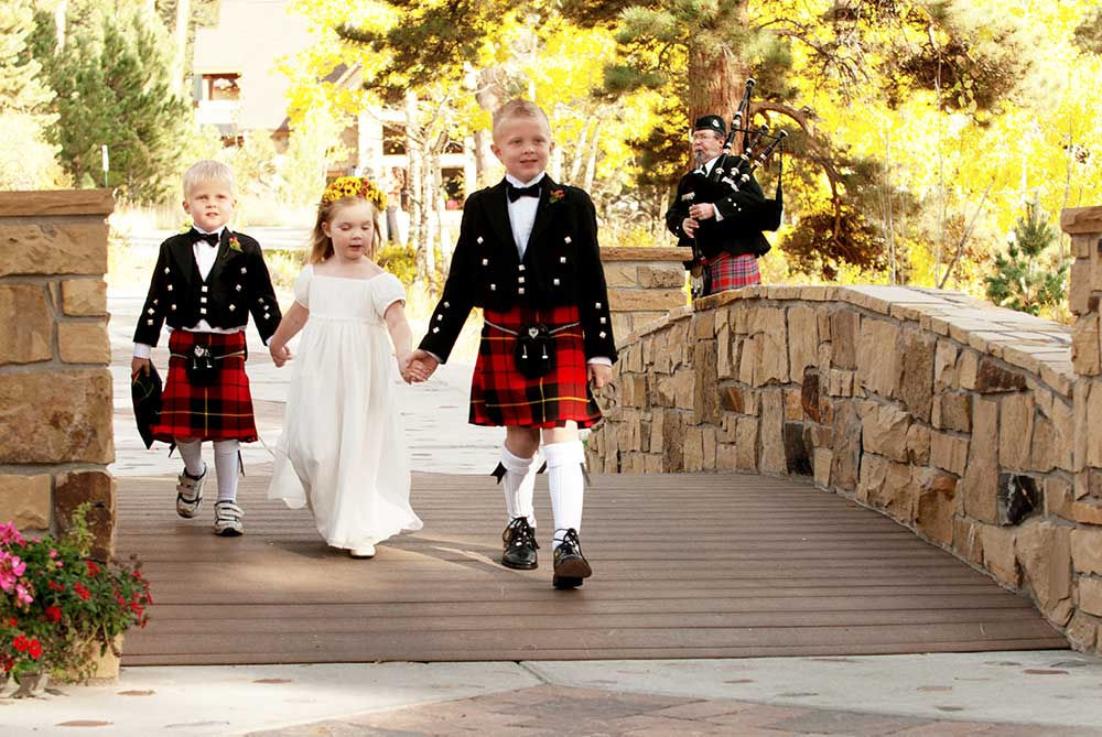 Bagpiper with kids
